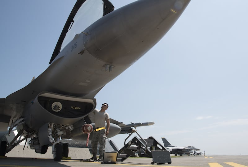 U.S. Air Force Staff Sgt. Sonethasinh Sayasaeng, a 35th Maintenance Squadron avionics technician, prepares an F-16 Fighting Falcon for an M7.1 upgrade at Misawa Air Base, Japan, July 13, 2017. The upgrade will provide pilots with more tactical information to be applied to dynamic missions. (U.S. Air Force photo by Airman 1st Class Sadie Colbert)