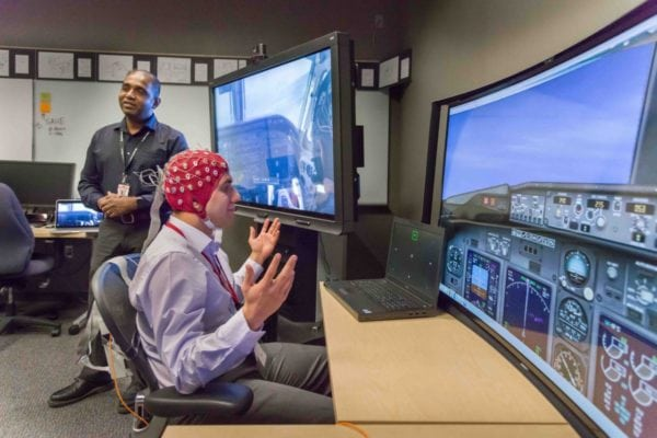 A demonstration of the use of human brain waves to provide inputs for flight controls inside of Honeywell's Advanced Technology lab for neural sensing technology. Photo: Honeywell Aerospace.