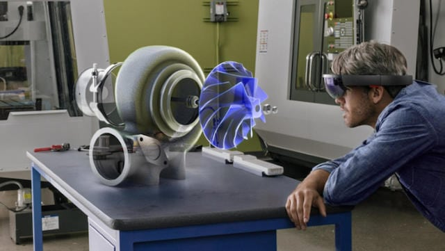 An engineer visualizes a mechanical hologram with Microsoft's Hololens smart glass technology. Photo: Microsoft.