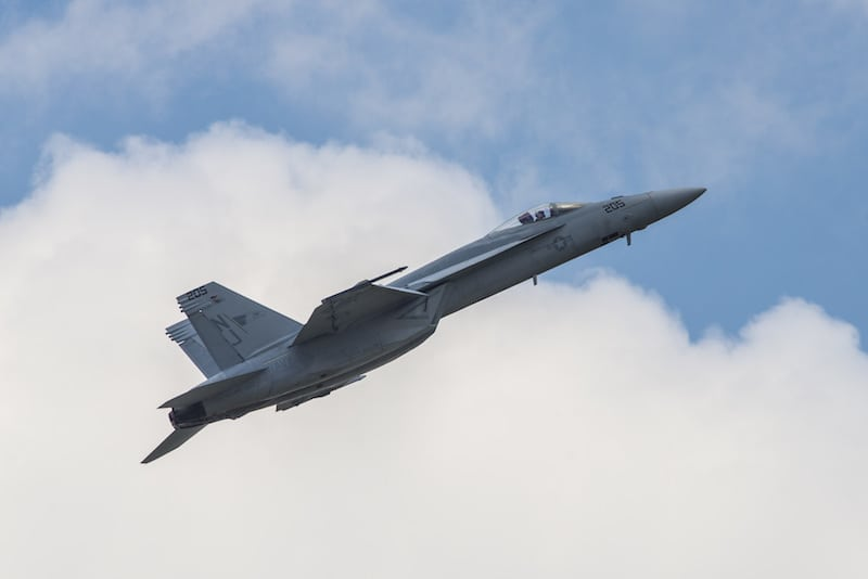 The U.S. Navy Tactical Demonstration Team executes tactical maneuvers in the F-18 Super Hornet during the 100th Centennial Celebration Air Show, June 11, 2017, at Scott Air Force Base, Ill. Boeing offers a suite of upgrades to the F/A-18 Super Hornet, including conformal fuel tanks, an enclosed weapons pod, an enhanced engine and a reduced radar signature. These capabilities, along with other advanced technologies, offer U.S. and international customers a menu of next-generation capabilities to outpace future threats affordably. (U.S. Air Force photo/Senior Airman Tristin English)