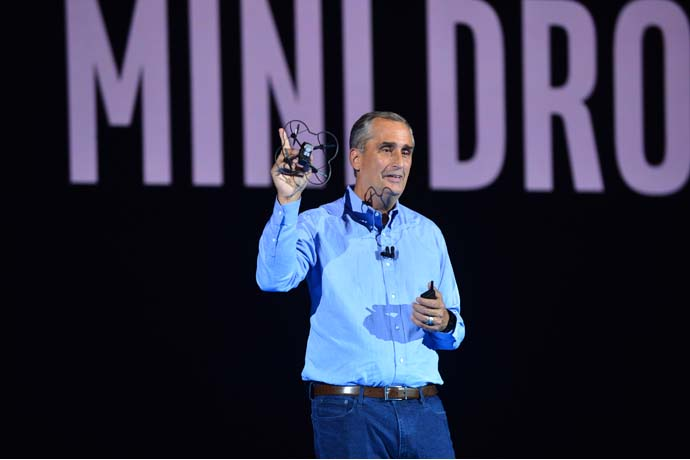 Brian Krzanich, Intel Corporation chief executive officer, displays a Shooting Star Mini drone during the 2018 Consumer Electronics Show (CES) preshow keynote address on Monday, Jan. 8, 2018, in Las Vegas. One hundred of the mini drones were later displayed in an indoor light show. Intel displays how the power of data is affecting our daily lives at the event, which runs Jan. 9-12. (Credit: Walden Kirsch/Intel Corporation)