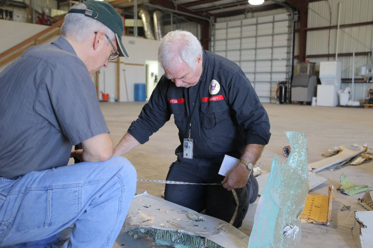 Atlas Air 3591 wreckage being examined by GE Flight Safety Manager Dan Kemme (left) and NTSB Senior Investigator Jim Hookey (right). (NTSB)