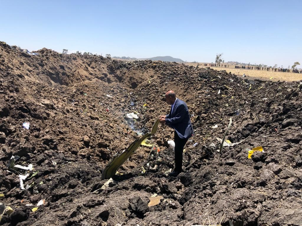Ethiopian Airlines Group CEO Tewolde GebreMariam amid the wreckage of Flight ET 320. (Ethiopian Airlines)