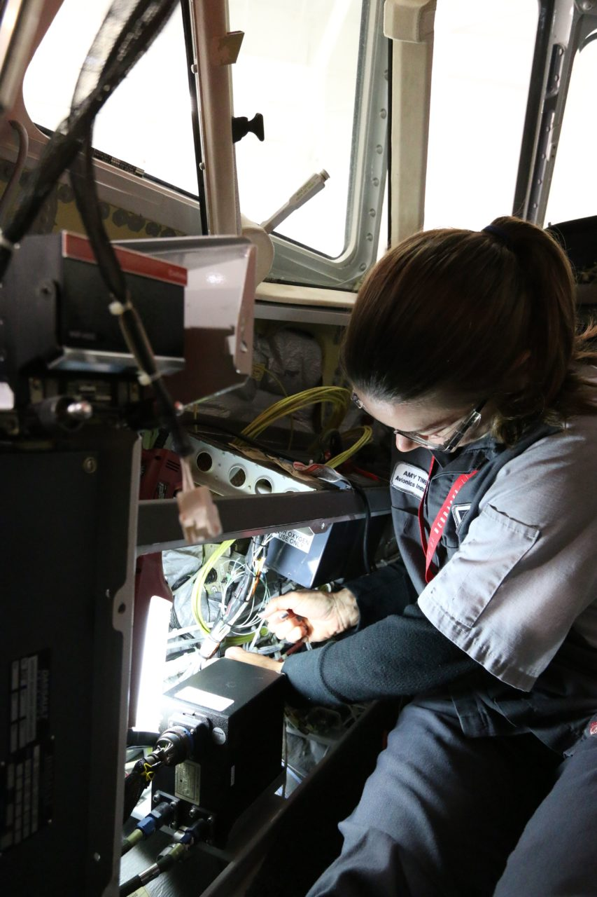 A Duncan Aviation technician installing avionics. (Duncan Aviation)