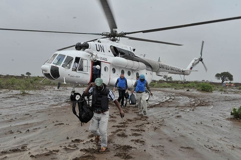 United Nations workers in Somalia disembark from an Mi-8MTV helicopter in November 2014. (United Nations)